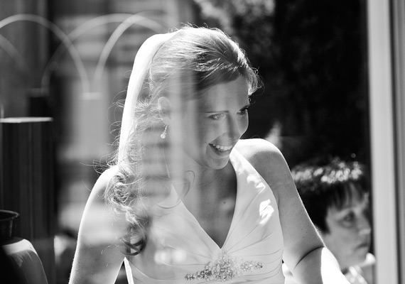 A wedding in Groot-Bijgaarden near Brussels in mid-summer. A view of the beautiful bride through the window. How I love snapshots!